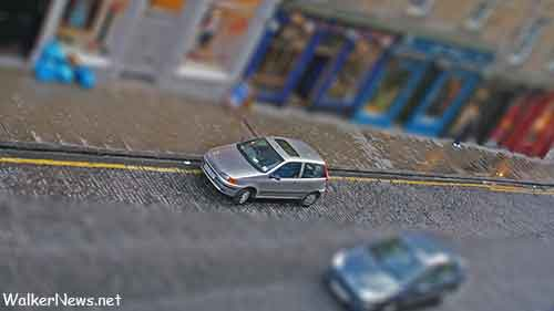 It is easier to use Photoshop CS6 to create tilt-shift / miniature effect.